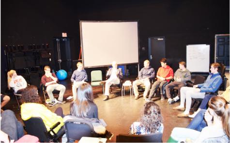 Students gather around Paul Barrett to discuss U.S. gun policy.