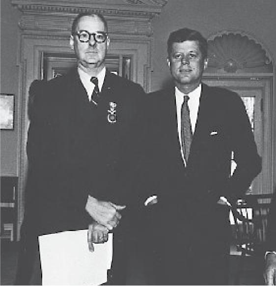 Richard M. Bissell poses alongside John f. Kennedy