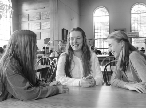 Anna Cardy laughs with friends after a meal in the Dining Hall.