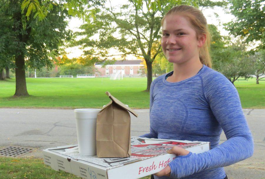 Chloe White '19 picks up an order from the Cottage in Ayer.