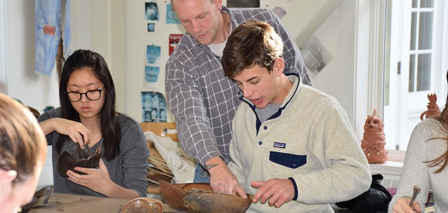 Silas Finch works with Nico '17 on a project during a workshop.