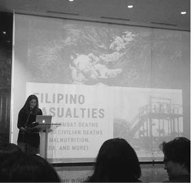 Ms. Wallace delivers a lecture at a Filipino library.