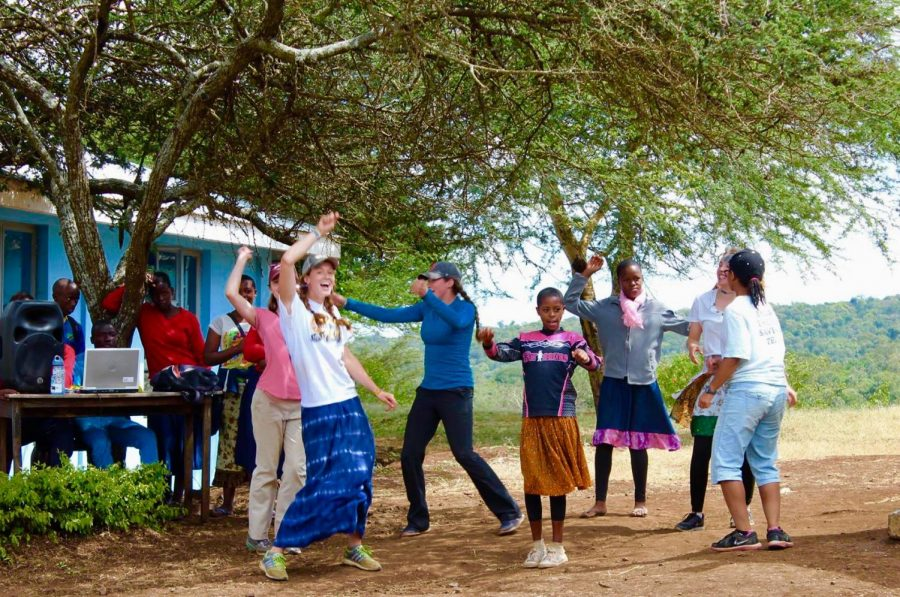 Students dance during a trip to Tanzania in 2016.