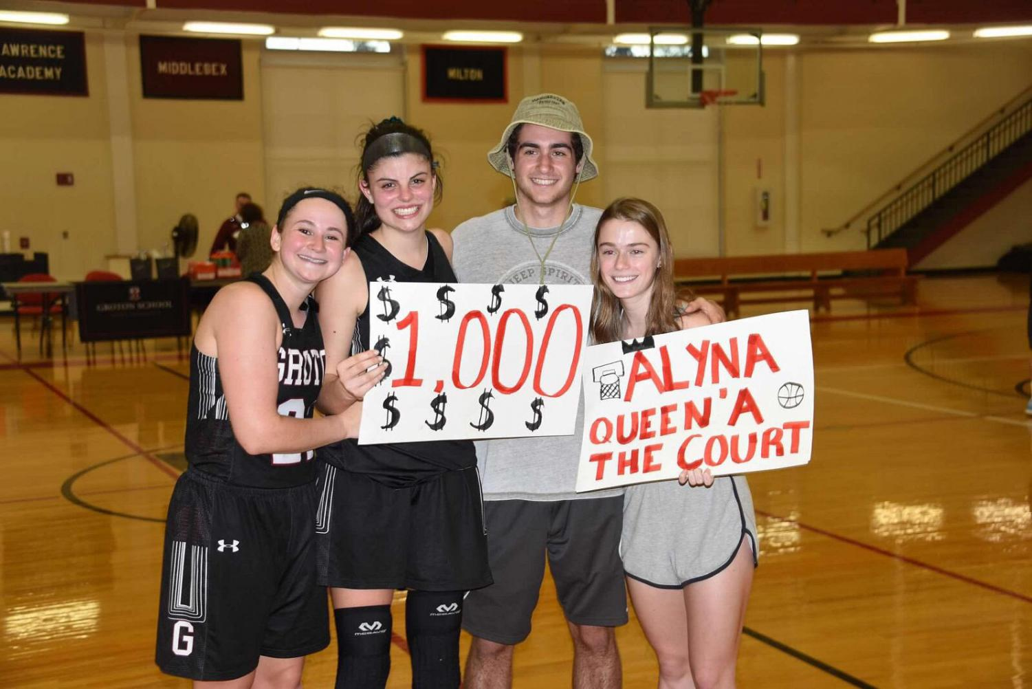 Alyna with friends after scoring her 1,000th point.