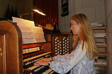 Chip practicing organ in the chapel.
