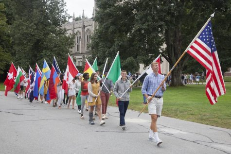 Students carrying flags at Convocation.