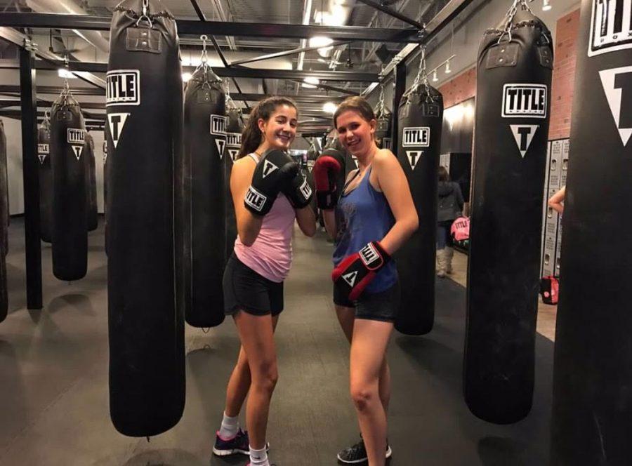 Elizabeth and Mary kickboxing.