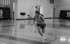 Rachel driving to the basket for a layup, a skill she's dubbed her specialty.