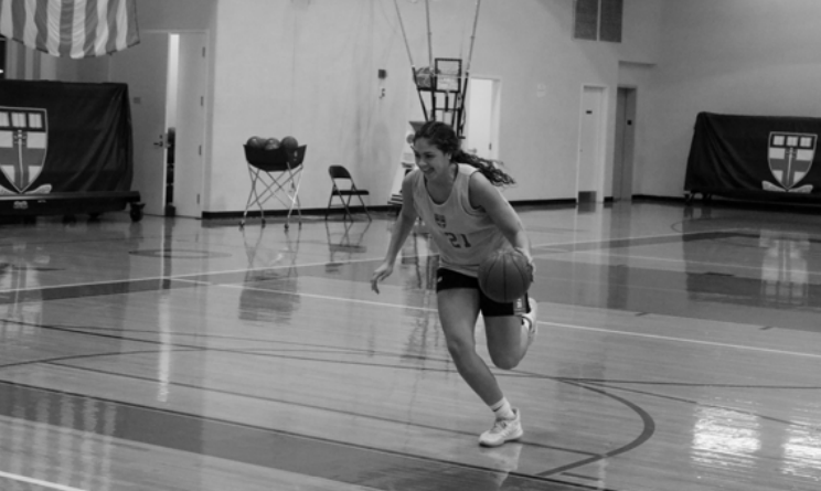 Rachel+driving+to+the+basket+for+a+layup%2C+a+skill+she%E2%80%99s+dubbed+her+specialty.
