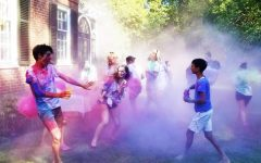 Students celebrating Holi in the Dases' backyard last spring.