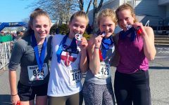 Runners Olivia Dillon '21, Hannah Wise '21, Cornelia Potter '21, and Anna Copeland '20 after finishing the half-marathon.