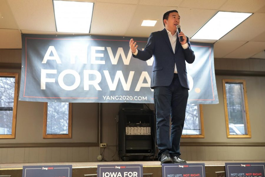 Andrew Yang speaking at a rally in Iowa.