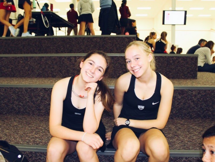 Katherine Sapinski '21 (left) during a squash match, courtesy of Angela Wei '21