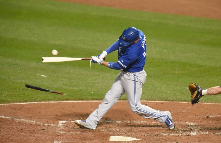 BALTIMORE, MD - SEPTEMBER 28: Ryan Goins #17 of the Toronto Blue Jays breaks his bat in the fifth inning during a baseball game against the Baltimore Orioles at Oriole Park at Camden Yards on September 28, 2015 in Baltimore, Maryland. The Blue Jays won 4-3.   Mitchell Layton/Getty Images/AFP == FOR NEWSPAPERS, INTERNET, TELCOS & TELEVISION USE ONLY ==